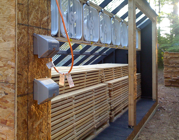 Passive solar kiln designed and build specially for hybrid timberframe project.