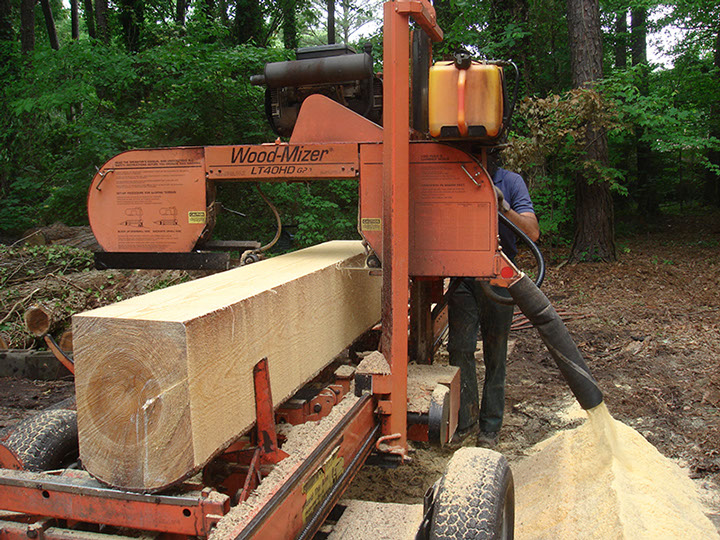 Paul Garrity Sawyer reducing home grown pine to lumber on site.
